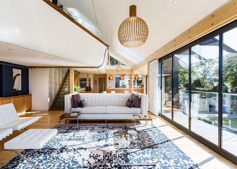 Above the living area is the structural curved-plywood study mezzanine.