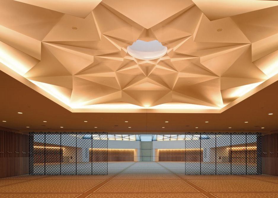"""The """"Muqarnas"""" is a finely crafted corbelled ceiling whose skylight provides a subtle transition from the outside to the serene Jamatkhana inside."""