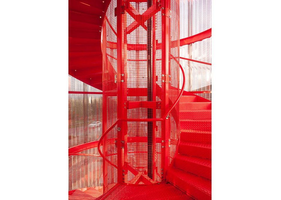 These days, this is a heritage colour. 1970s-red exterior staircase. Credit 6a