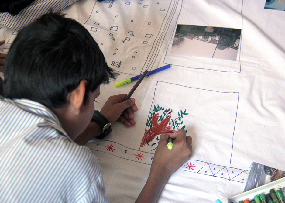 The class collectively make a map of their neighbourhood using photographs, drawings and annotations, 2014.