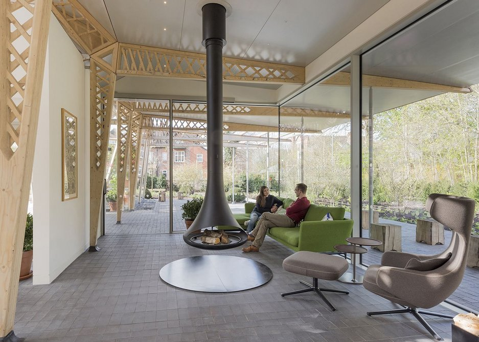Foster + Partners' Maggie's Centre in Manchester avoids institutional references and instead has a warm material palette including timber lattice beams.
