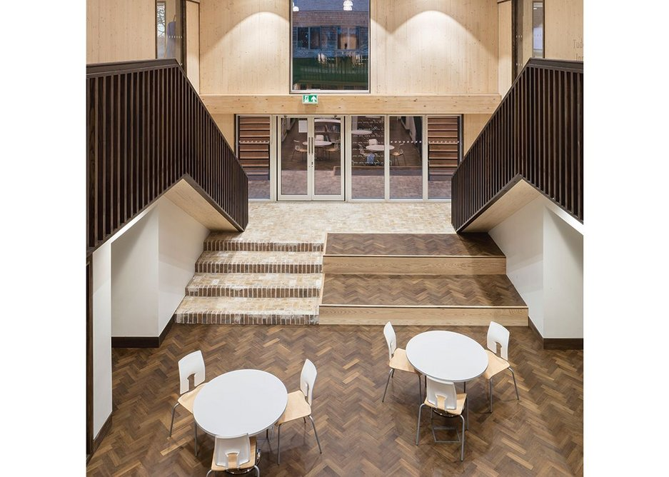 The classroom cluster around this generous central space that operates as relaxed library, circulation and extra work space. It opens up onto the grass on one side and, with sliding doors, a classroom on the other.