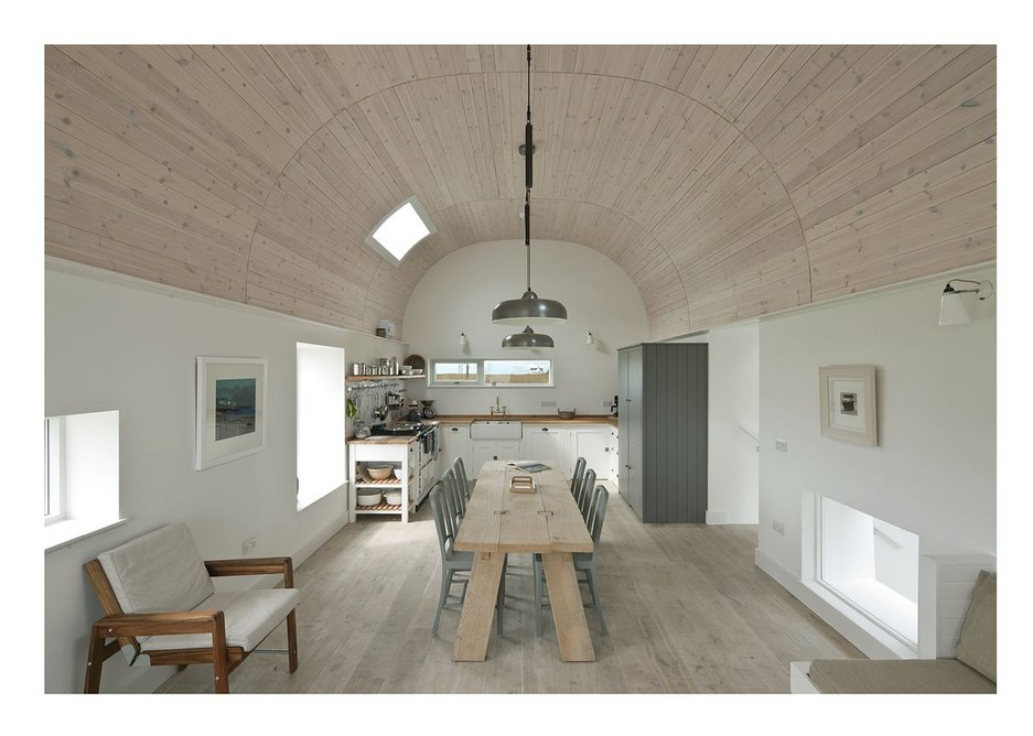 The living house has a tunnel-shaped ceiling.