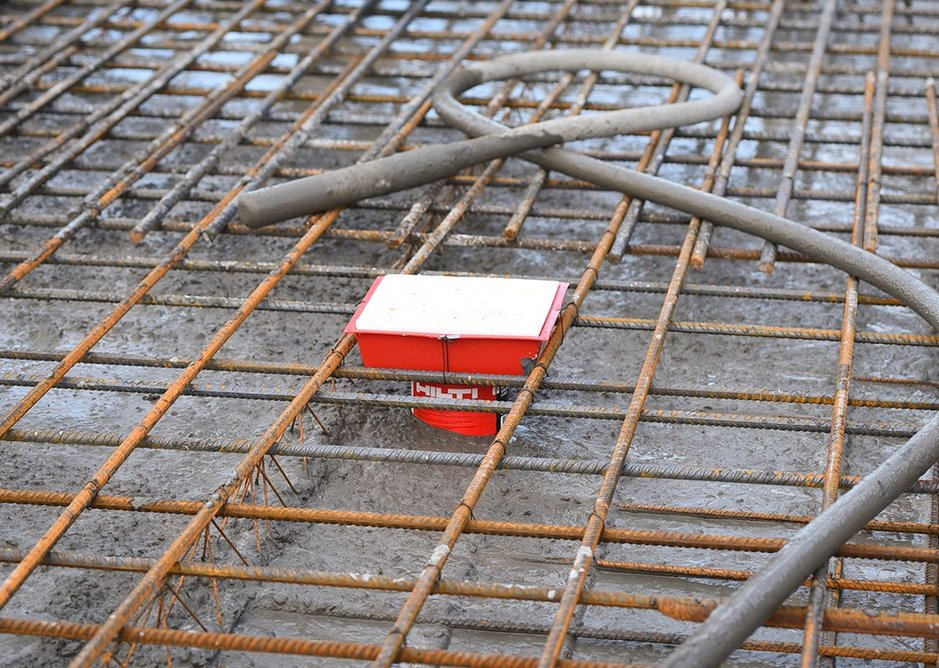 The square opening at top of slab level...