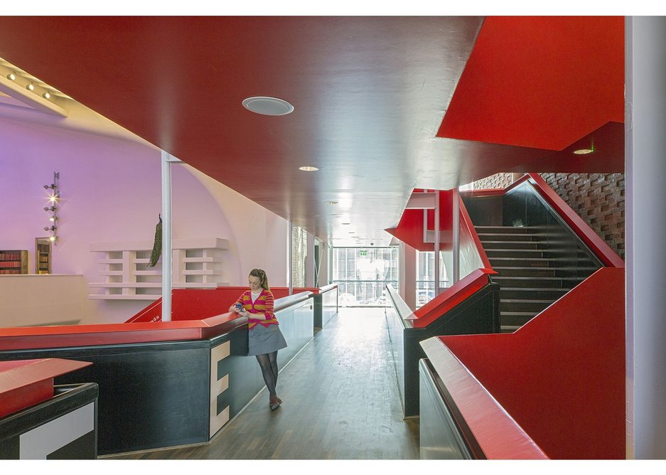There is a pleasing level of complexity about the red stairs and the way they branch off. Chester Storyhouse, Bennetts Associates.