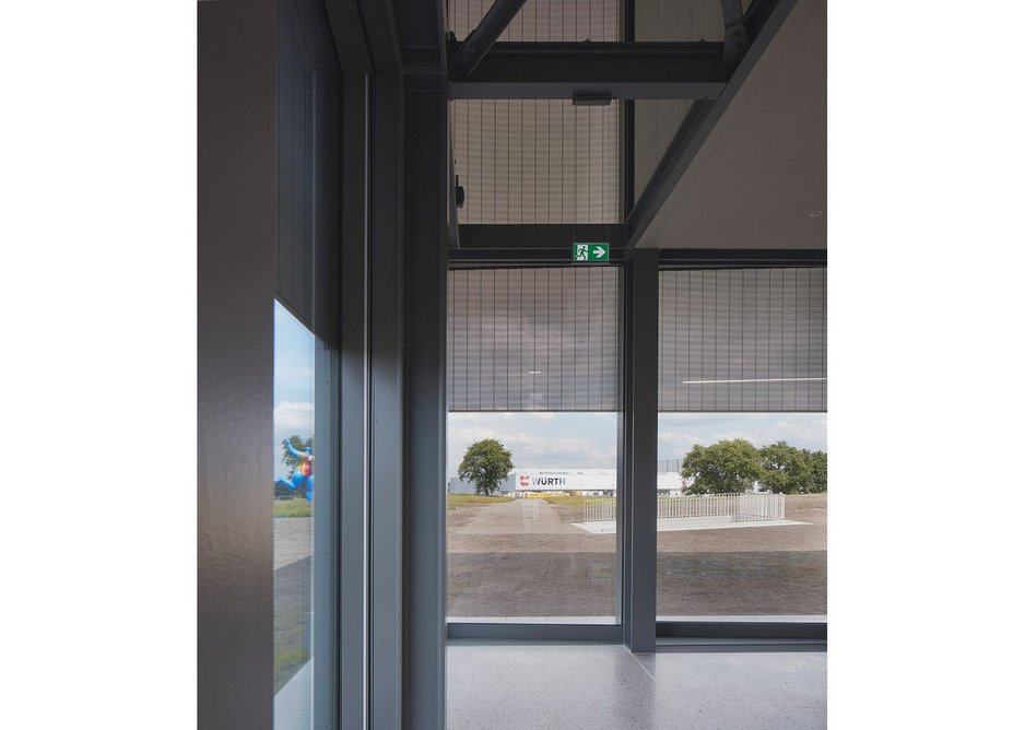 Fine steel mesh shutters silently glide  up and down in front of the glass, dealing with solar gain.