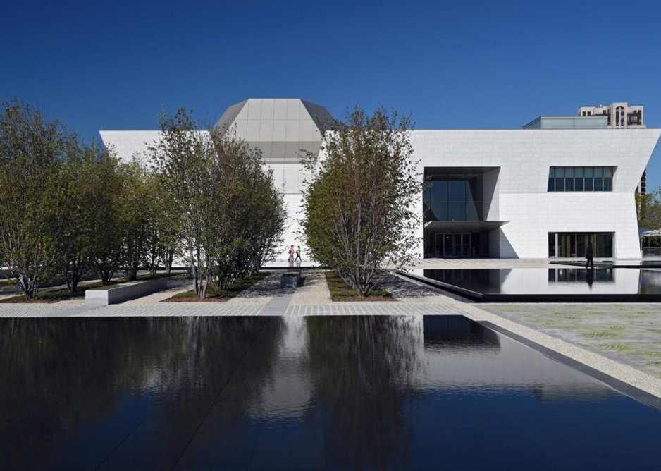 The chiselled white granite-clad form of Maki's museum with auditorium and dome.
