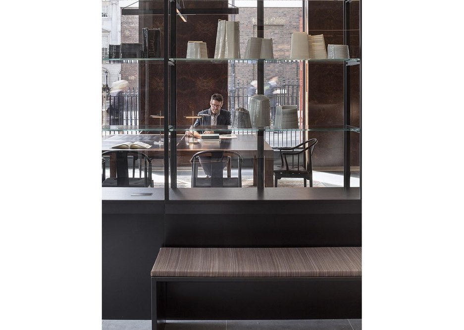 The ceramics in the vitrine reflect the history of the site as a Wedgewood showroom