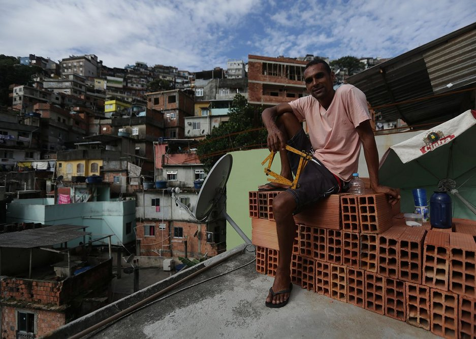 Self-trained favela architect Ricardo de Oliveiro plans to extend his house in Brazil into a five-floor building.
