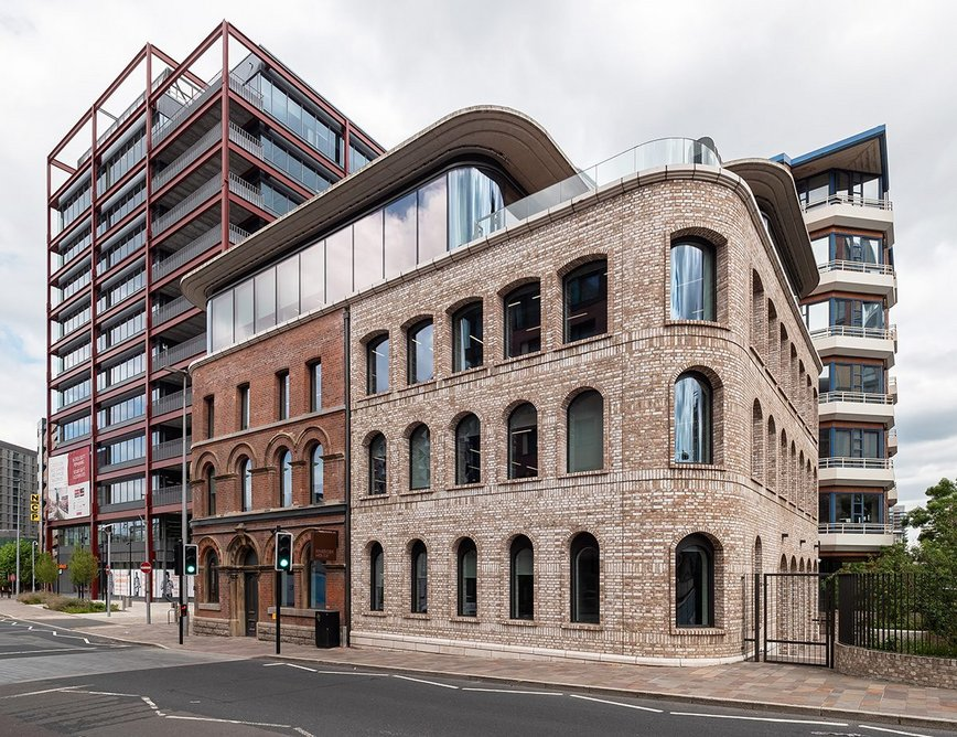 Riverside House is part of a wider development that also incorporates the Two New Bailey structure to the left.