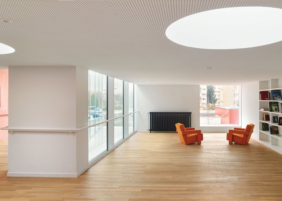 The upstairs library and reading area is lit with the help of circular skylights.
