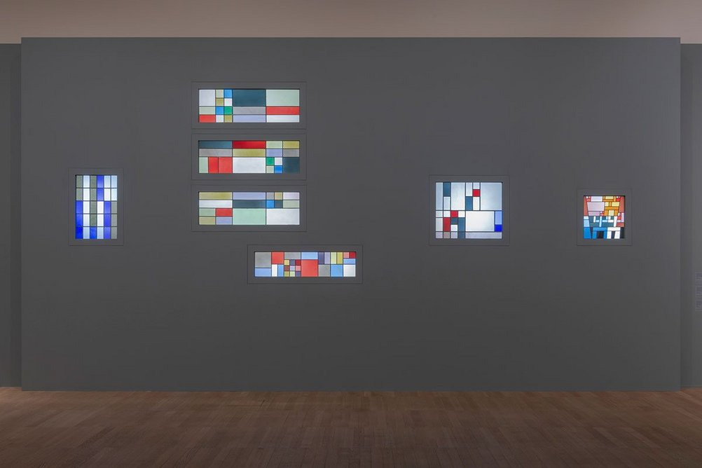 Installation image of the exhibition Sophie Taeuber-Arp showing stained glass windows designed by her for the home of the collector Andre Horn.