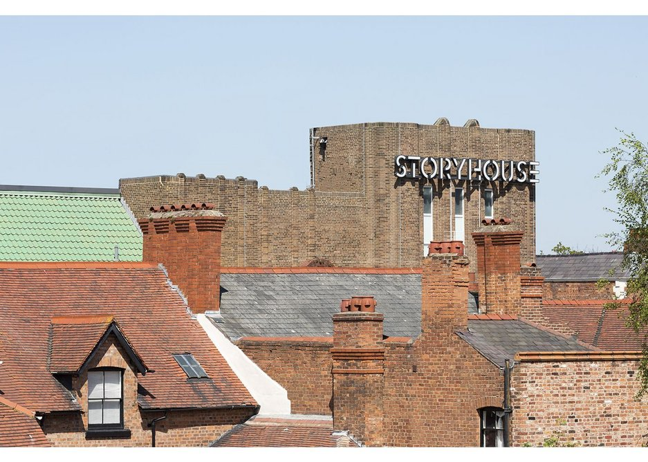Storyhouse among the roofs and chimneys of the city. Chester Storyhouse, Bennetts Associates.