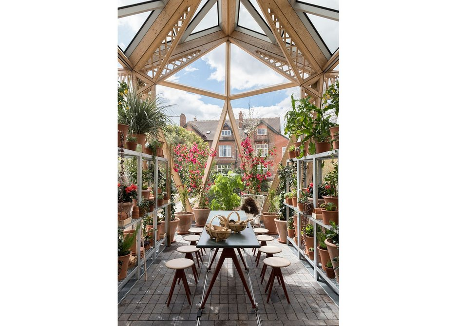 The greenhouse demonstrates both the welcoming nature of the building and its transparency.