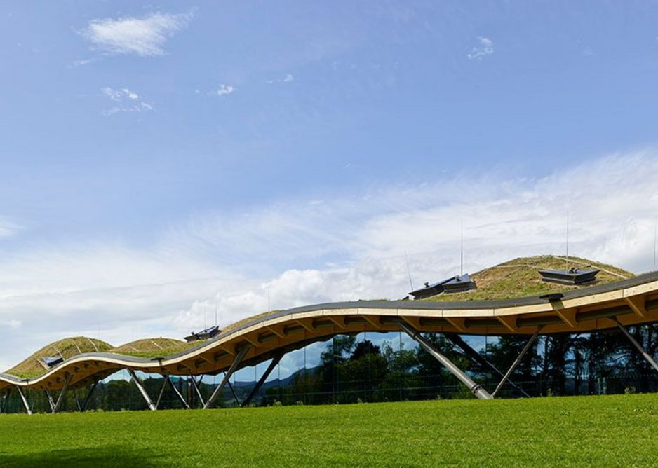 The building opens out with walls of glass to address the dramatic Speyside landscape.