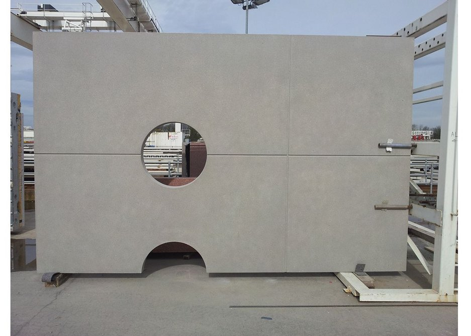 Shear concrete panel with punched circular window holes. Factory production was used for 60% of the Cancer Centre.