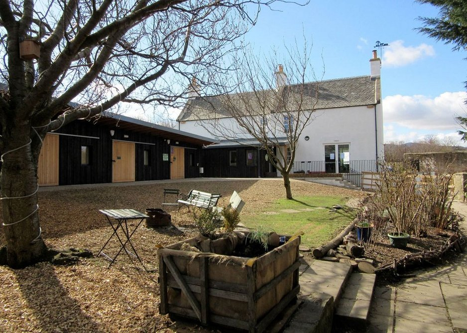 A quieter day in the court with the overhangs of the workshops and the new porch visible. MacEwen Award 2019 commended Bridgend Inspiring Growth, Edinburgh by Halliday Fraser Munro Architects for Bridgend Inspiring Growth
