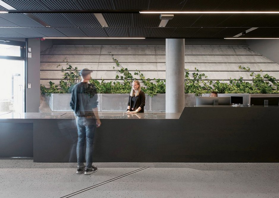 The exposed concrete ground floor reception desk.