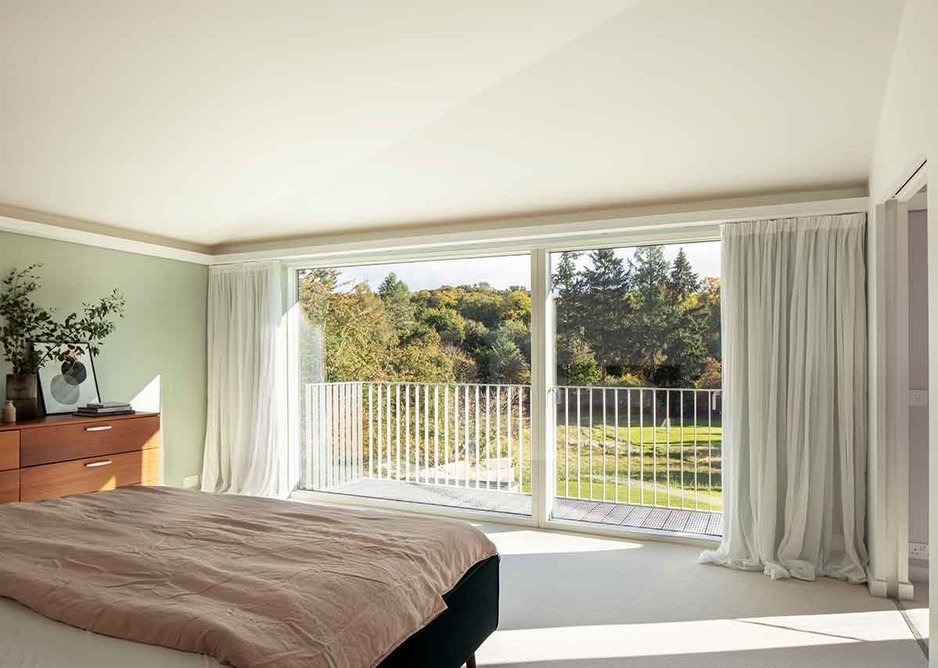 Master bedroom and balcony with views onto the landscape.