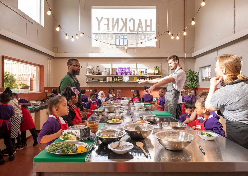 Teaching kitchen at Hackney School of Food, designed by Surman Weston. The room can accommodate 30 children at adjustable height counters.