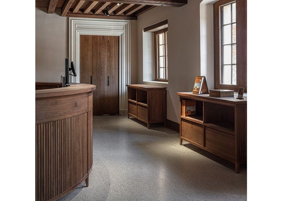 Ticketing desk and furniture were designed by HCV. Beyond, a new door sits in a 1929 architrave.