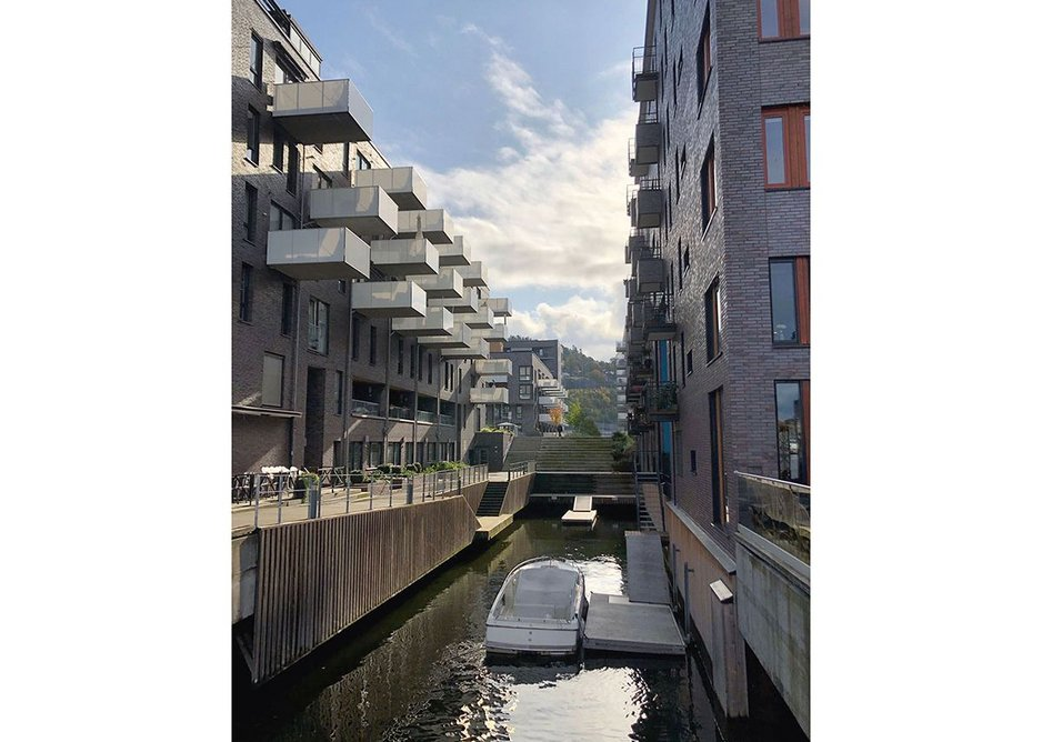 The former old container dock is now a new housing and leisure neighbourhood on the fjord with outdoor swimming pool and beach.