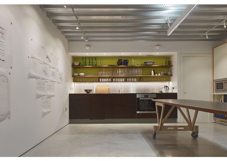 A magnetic wall and kitchen make for comfortable discussions on designs.