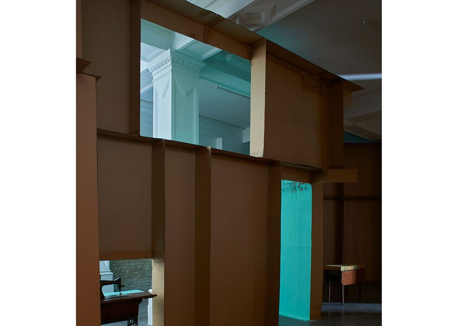 The installation responds to the structure of the gallery, which was formerly a library reading room.
