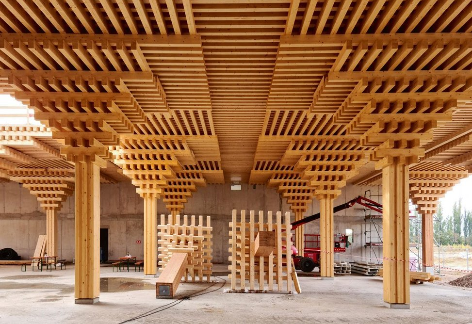 Components of the timber frame are prefabricated and bear on a piled concrete slab.
