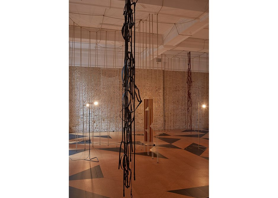 Leonor Antunes: The Frisson of the Togetherness at the Whitechapel Gallery. The installation incorporates hanging ropes, nets and leather straps with references to both the gallery's locality and exhibition heritage.