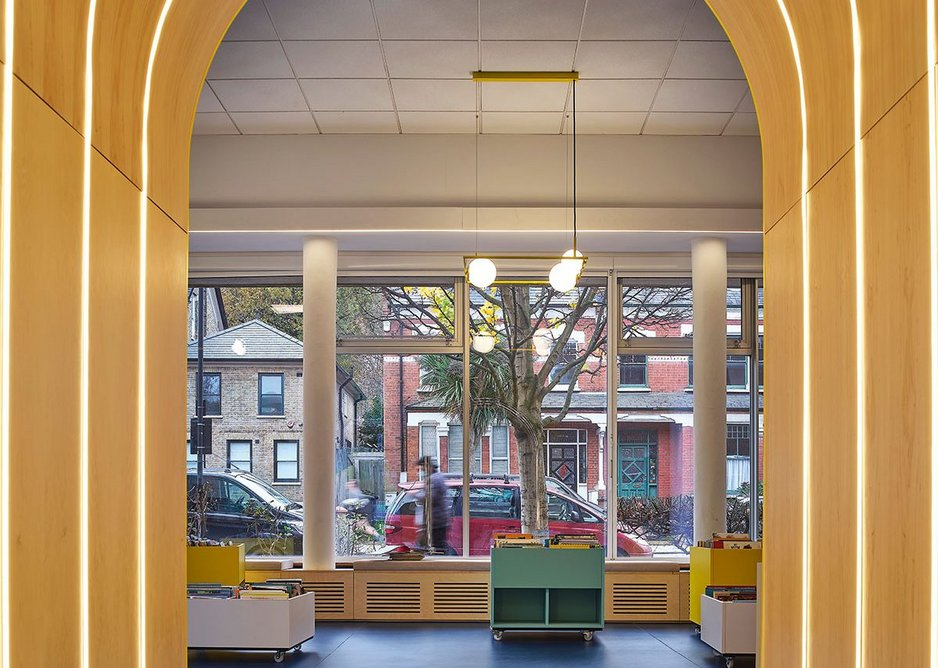 The children's library with its new sunny entrance, colourful book bins, seating and flooring.