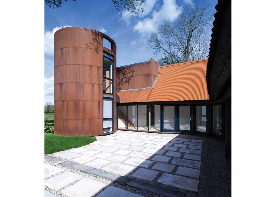 Dyson's 'gasometer' drum becomes a focus for the kitchen courtyard.