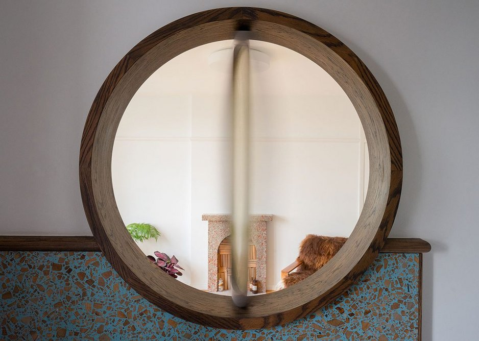 Crafted out of four pieces of turned curved oak, the frame and window form a connective centre piece between the living room and kitchen.