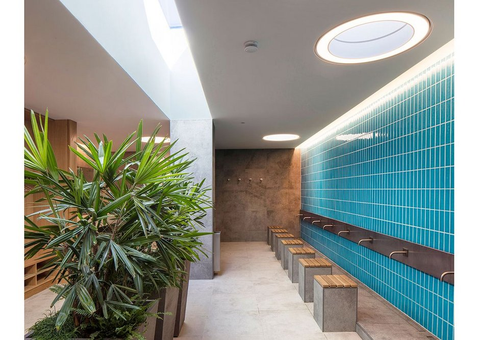 The male ablution space is bathed in natural light from above. The hot water is powered by PVs, and rainwater is harvested for flushing WCs.