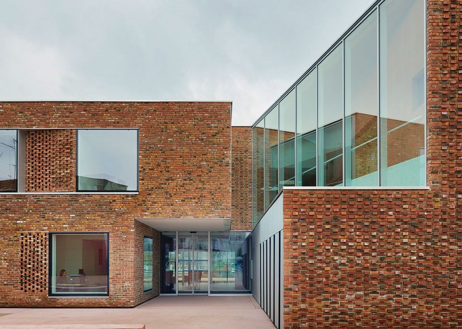 Visitors to the main entrance can easily find their way in by slotting between the gap of the two main building volumes.
