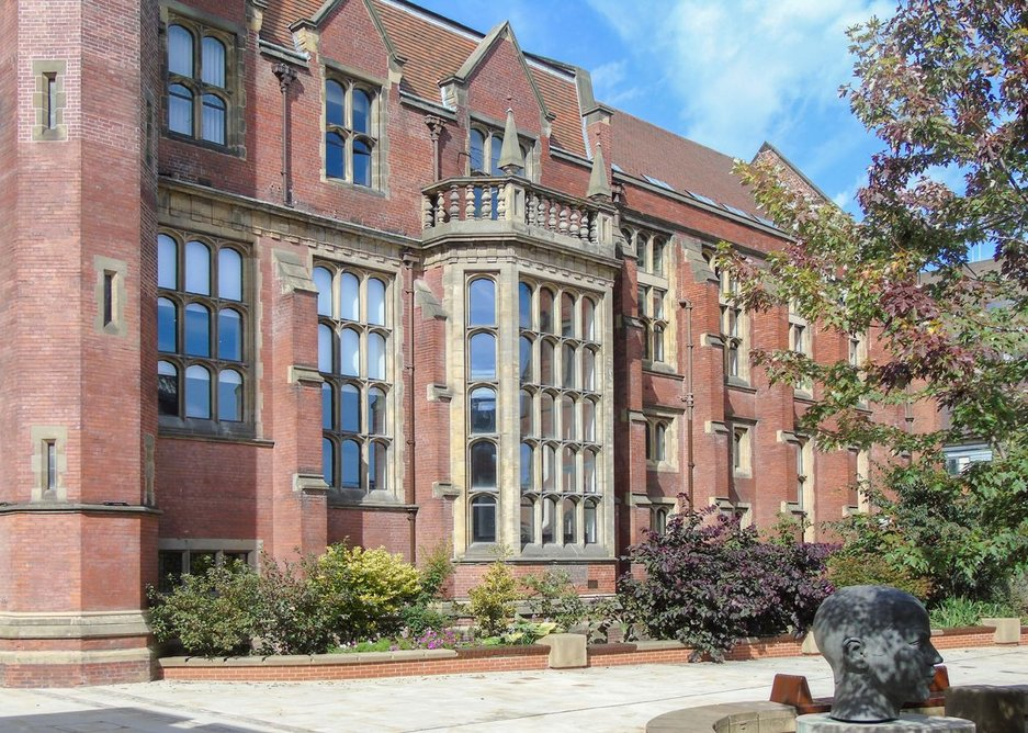 Newcastle University's Armstrong building. Architectural Bronze Casements made shaped double-glazed bronze windows to fit the stone surrounds.