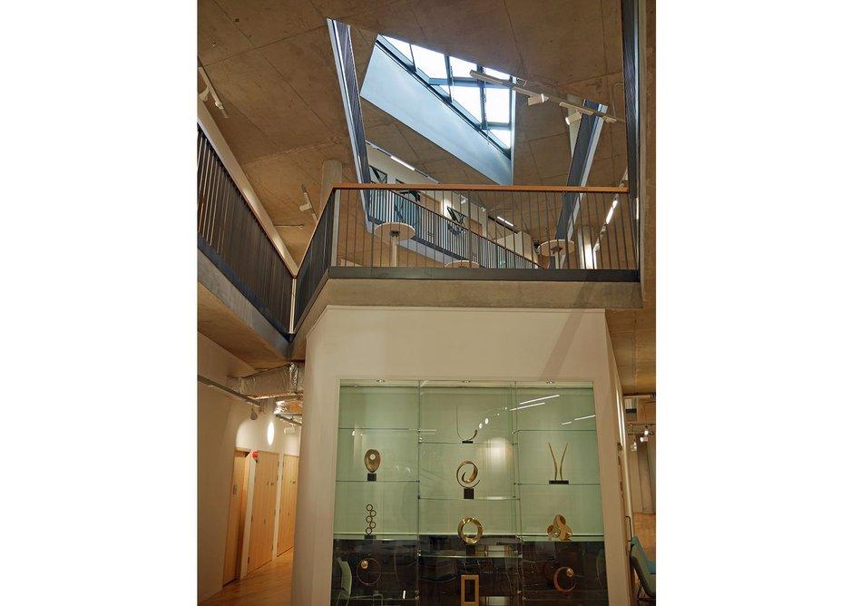 Oblique views upwards through the three floors.