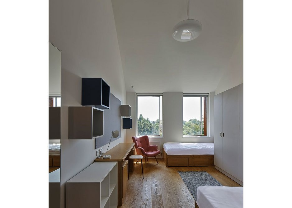Twin bedrooms are of generous proportions, each with a shared ensuite bathroom. The timber floor theme runs throughout.