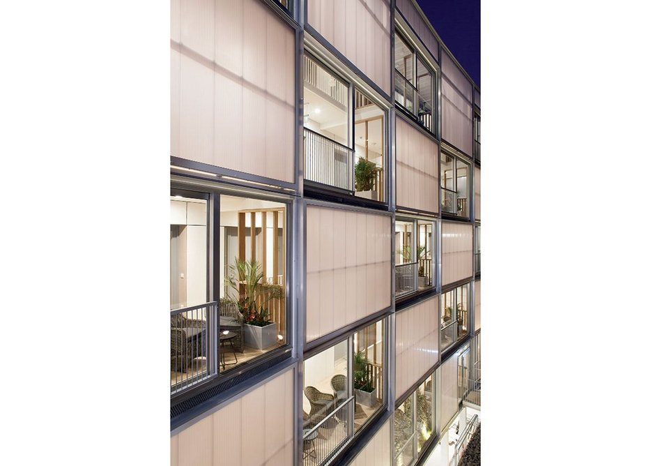 Polycarbonate cladding creates a chequerboard effect on the facade.