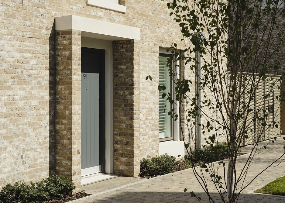 Front doors in a selection of colours and tiny porches make each house or flat more of a home.