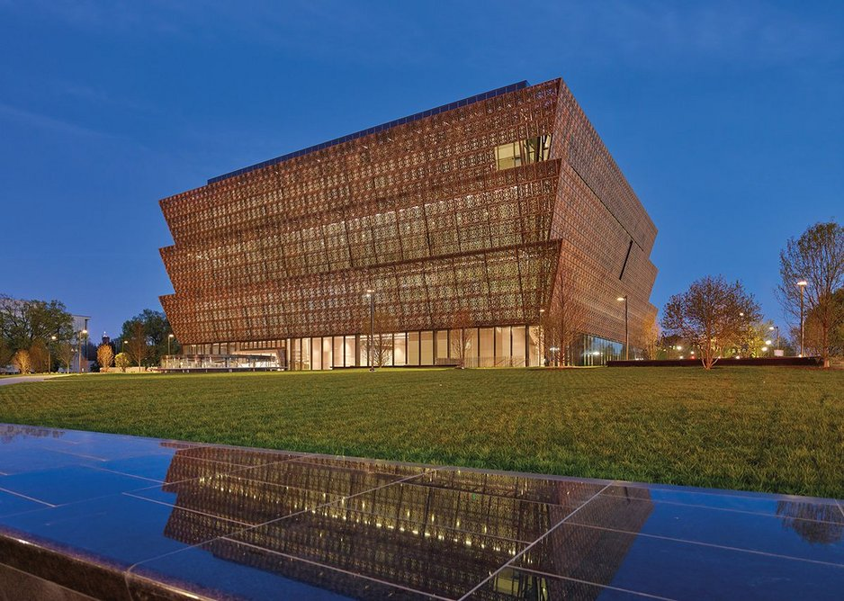The bronze alloy-coated aluminium facade is a step down from Adjaye's proposed solid bronze, but the permeability of this 'African crown' is all there.