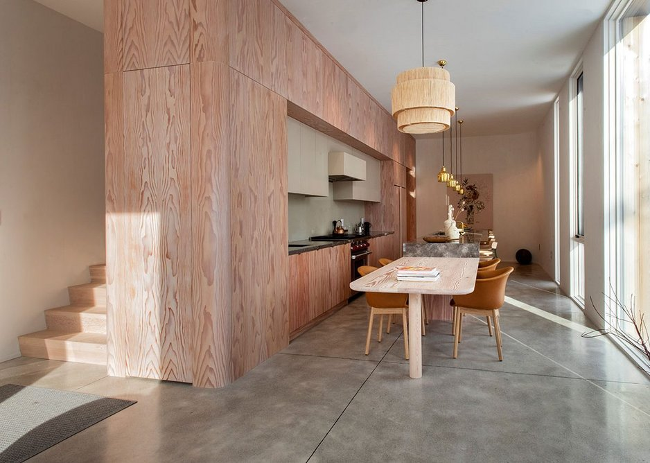The kitchen with its wood cupboards and Brazilian stone island.