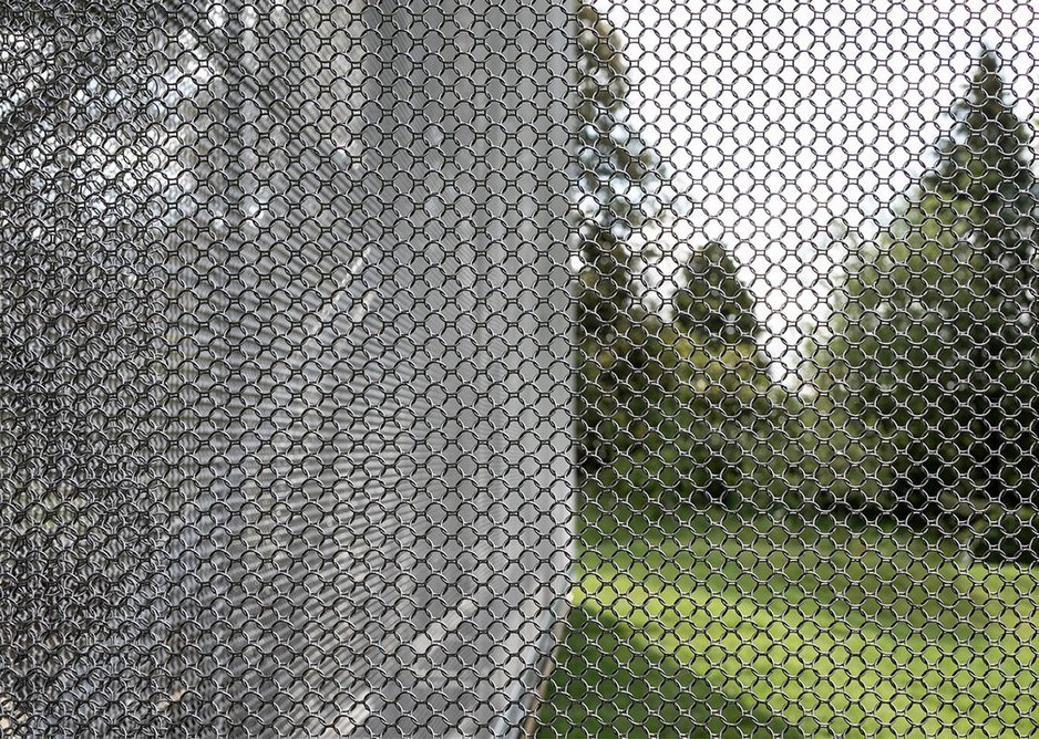 The gauze helps prevent rain but lets the house and, as importantly, its garden, breathe.