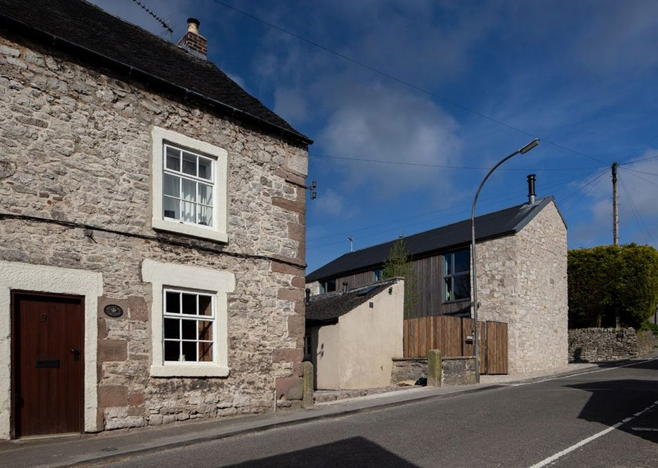 James Boon Architects, view of Stackyard from the street. This new build project in a conservation area in the middle of a Derbyshire village is the architect's own home and was delivered on a tight budget.
