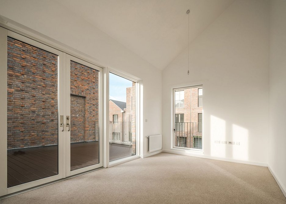 First floor double height living spaces have generous external terraces.