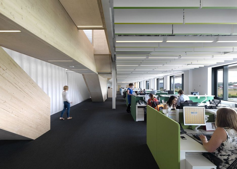 Threefold's timber corridor through the offices articulates an otherwise prosaic  two floors with dramatic geometries.