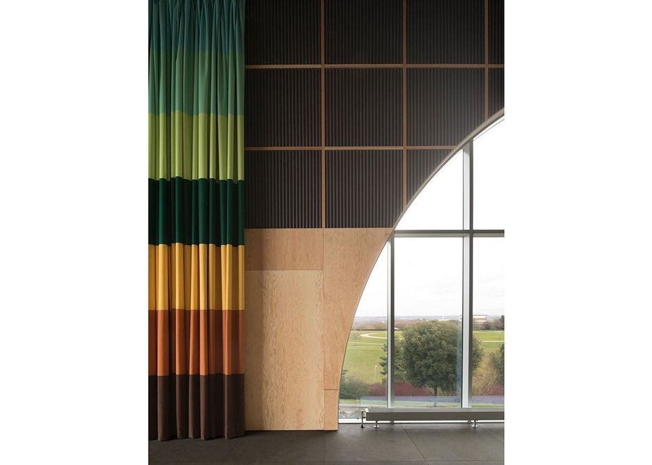 The clever and colourful curtain creates blackout and divides the space in several ways. Credit 6a.