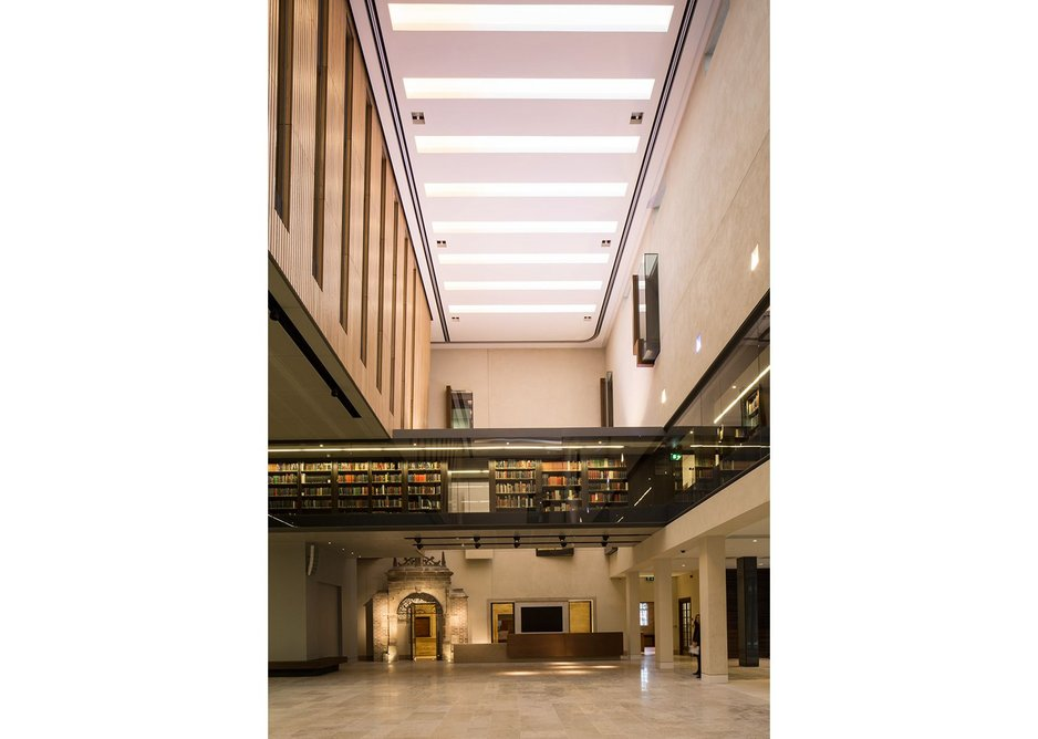 The Blackwell Hall looking east showing the first floor open access shelving and the hall's palette of Jura limestone, rough cast plaster and oak.