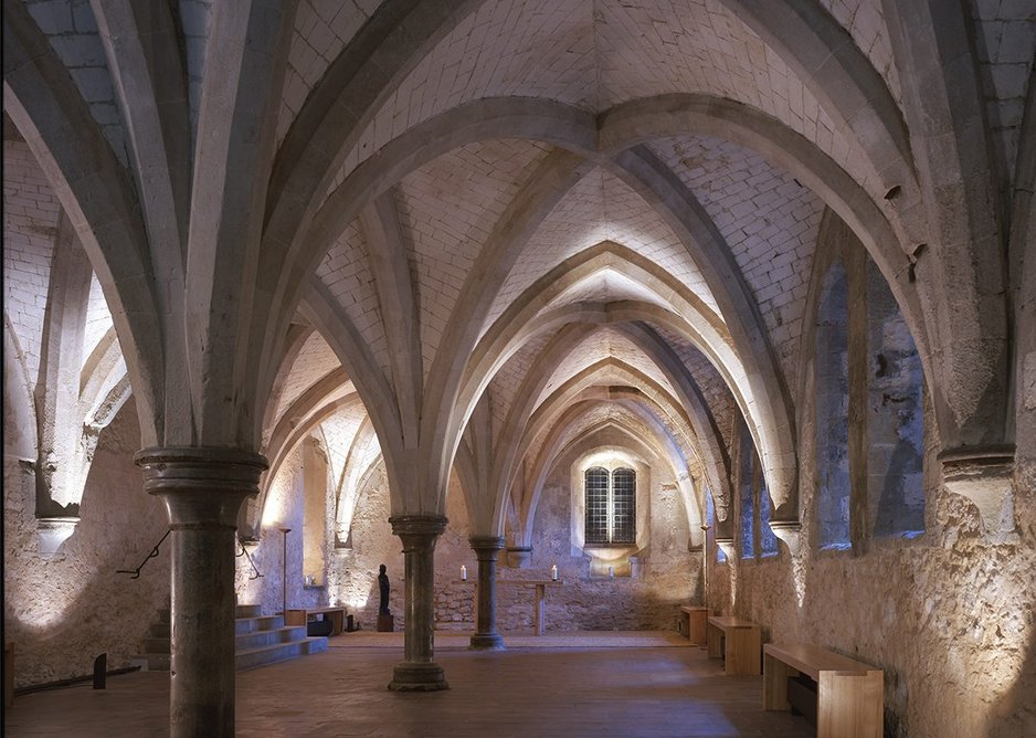 Minimal interventions at Lambeth Palace Crypt chapel with heating integrated into benches.