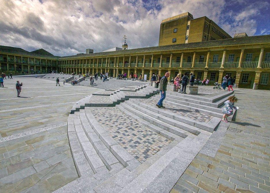 Portuguese Alpendurada Granite steps provide an elegant frame for the Yorkstone paving